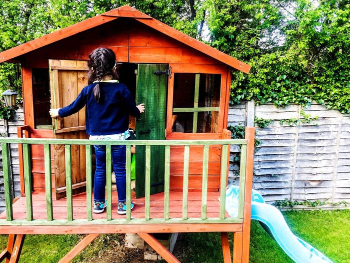 The Secret Spaces Wood - Material Full Length Real People Outdoors Building Exterior Architecture One Person Day Built Structure Lifestyles Tree People Girl Child Spring Garden Treehouse Playhouse Autumn Summer Nature Children Leisure Activity Kids Being Attentive