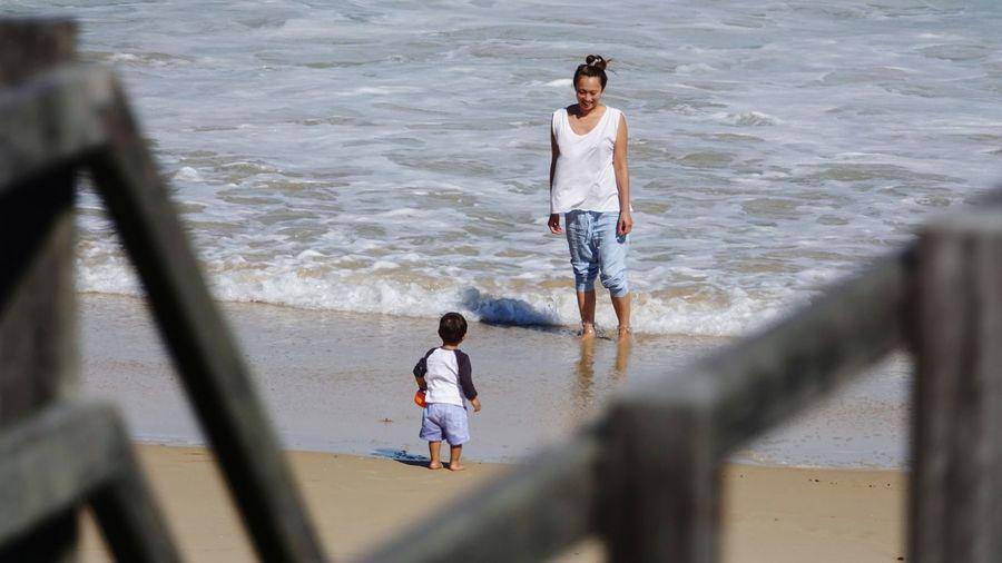 Boy walking in sea