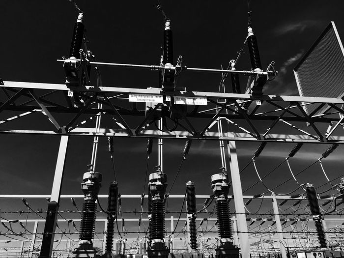 Low Angle View Of Transformers At Power Station