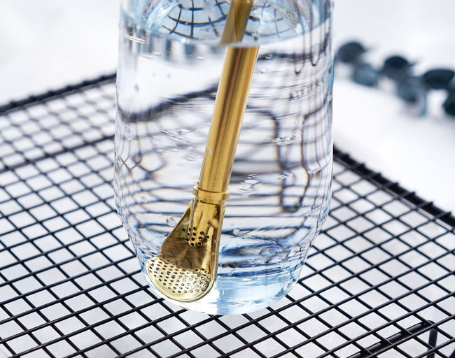 High angle view of drinking straw in jar on table