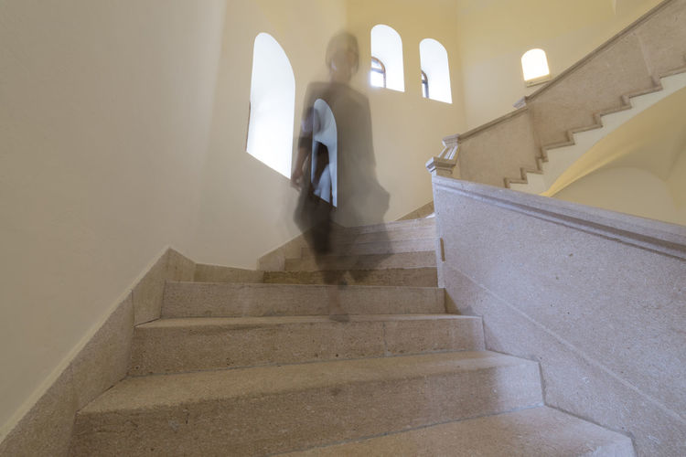 Low Angle View Of Female Ghost On Steps