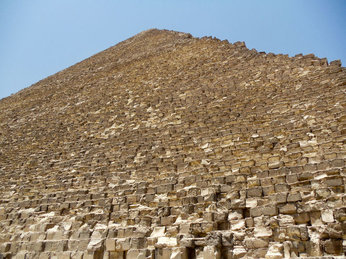 Low angle view of giza pyramid against clear sky