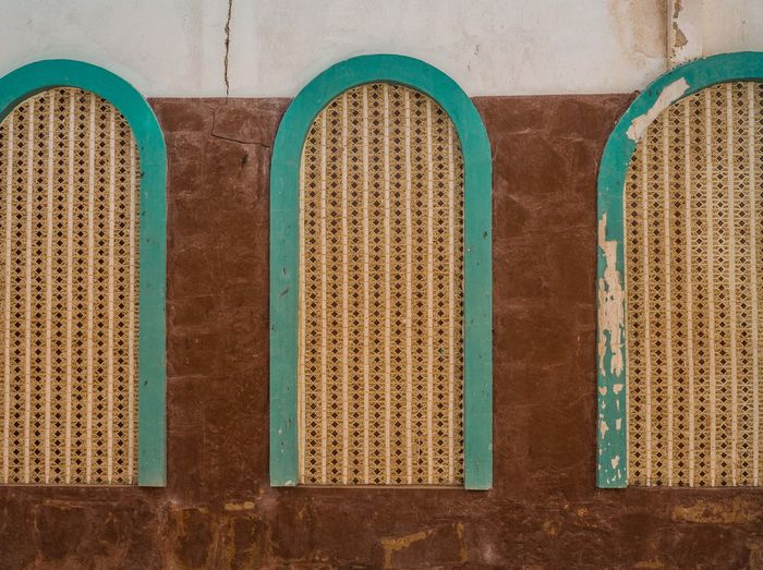 Oman Chapters Wall - Building Feature No People Built Structure Pattern Architecture Arch Building Exterior Day Building Close-up Window Blue Backgrounds Green Color Full Frame Outdoors Wall Side By Side In A Row