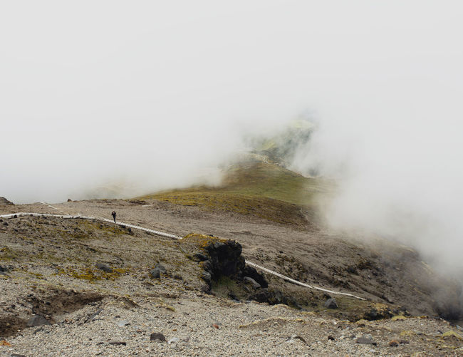 Scenic view of landscape amidst fog