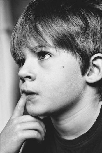 Close-Up Of Child Thinking