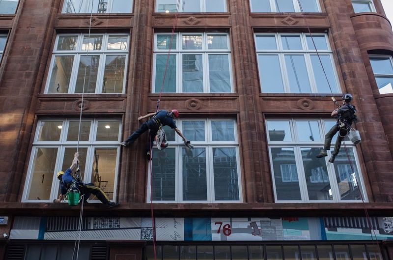 Low angle view of window washers working