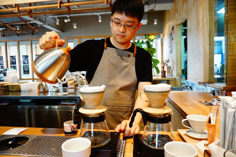 Drip brewing coffee One Person Real People Food And Drink Business Front View Indoors  Waist Up Holding Men Restaurant Household Equipment Standing Food Casual Clothing Kitchen Utensil Males  Cup Portrait Drink Preparation  Tray Coffee - Drink Coffee Cup EyeEm Best Shots EyeEmNewHere