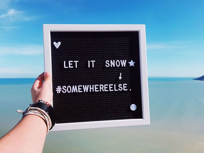 Let It Snow Summer Time  Summer Hate Winter Somewhere Else Let It Snow Human Hand Text Hand One Person Western Script Sky Human Body Part Sea Water Lifestyles Day Horizon Over Water Leisure Activity Personal Perspective Holding Message Women Close-up