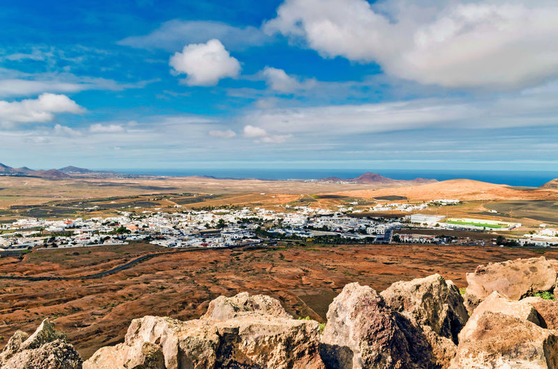 scenic view of the landscape of the island of Lanzarote against sky Pastel Colored Desert Mountain Blue Sand Sand Dune Sky Landscape Cloud - Sky Arid Climate My Best Photo