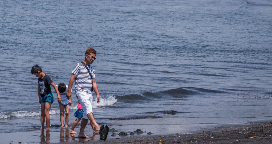 People on shore at beach