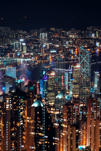 Aerial view of illuminated buildings in city at night