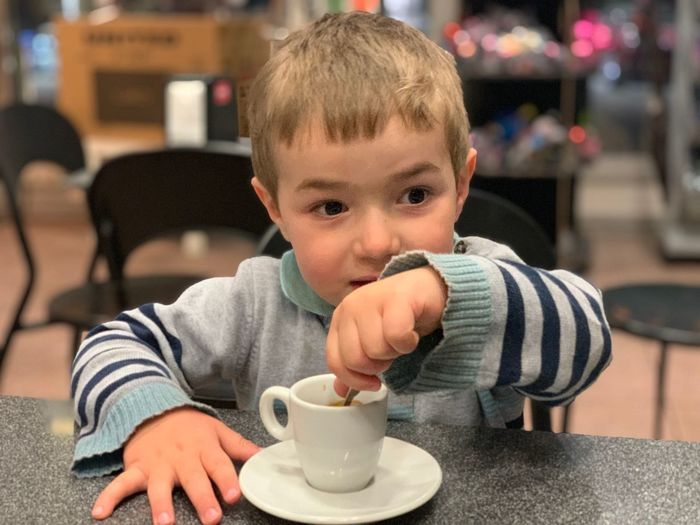 One Person Childhood Child Real People Males  Men Drink Boys Food And Drink Sitting Focus On Foreground Baby Restaurant Cute Indoors  Drinking Lifestyles Portrait Cup Innocence