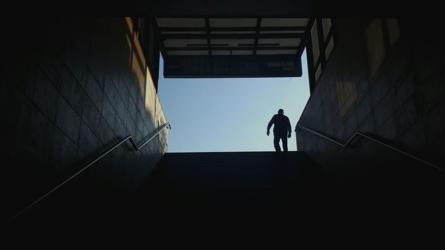Low Angle View Of Silhouette Man Seen From Silhouette Steps