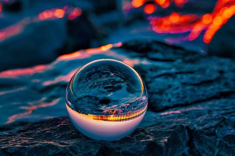 Lensball Reflection Crystal Ball No People Focus On Foreground Close-up Water Outdoors Planet Earth Day Illuminated Nature