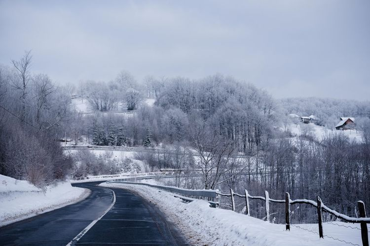 Holiday Moments Snow Cold Temperature Winter Tree Transportation Road Plant Nature Direction No People The Way Forward Sky Day Scenics - Nature Covering Bare Tree Beauty In Nature Architecture White Color Snowing Outdoors Snowcapped Mountain