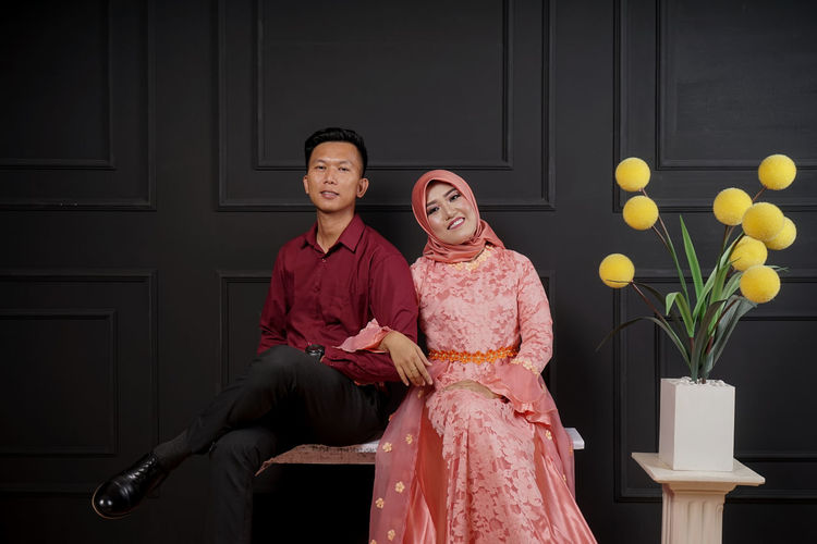 Two People Adult Women Emotion Togetherness Clothing Females Couple - Relationship Portrait Love Looking At Camera Traditional Clothing Heterosexual Couple Smiling Indoors  Happiness Men Positive Emotion Three Quarter Length Beautiful People