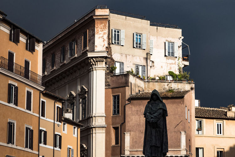 Statue of giordano bruno against buildings at campo de fiori