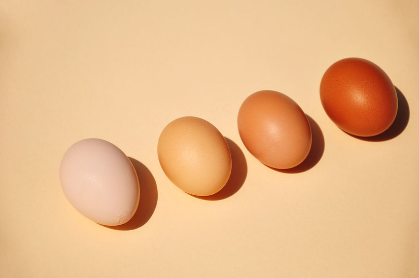 High Angle View Of Four Brown Eggs Horizontal In A Row The Week On EyeEm Animal Egg Brown Color Close-up Color Image Dairy Product Egg Food Food And Drink Four Objects Fragility Freshness Healthy Eating High Angle View Indoors  Ingredient No People Orange Color Photography Raw Food Studio Shot