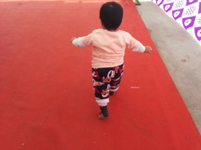 Rear View Full Length Fun One Person People Red Childhood Children Only Outdoors Child Day Real People Adult Little Boy Running On Red Carpet