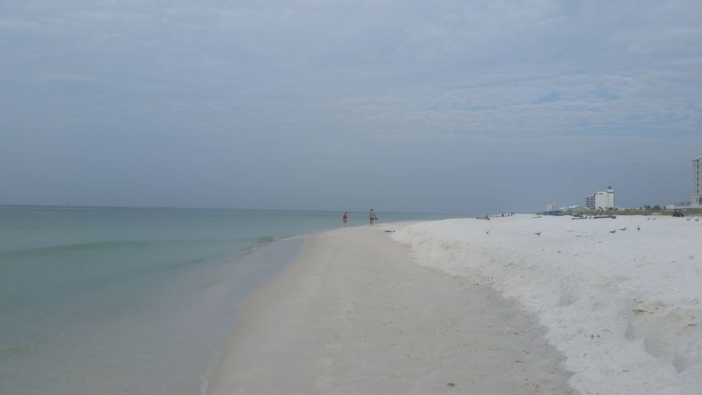 The Emerald Coast Beach Sea Sand Vacations Horizon Over Water Travel Destinations Landscape Water Sky Tranquility Nature Tranquil Scene Water's Edge Outdoors Day Beauty In Nature Scenics Two People Summer Emeraldcoast Emerald Coast Emerald Green Breathing Space in Pensacola Beach, Florida