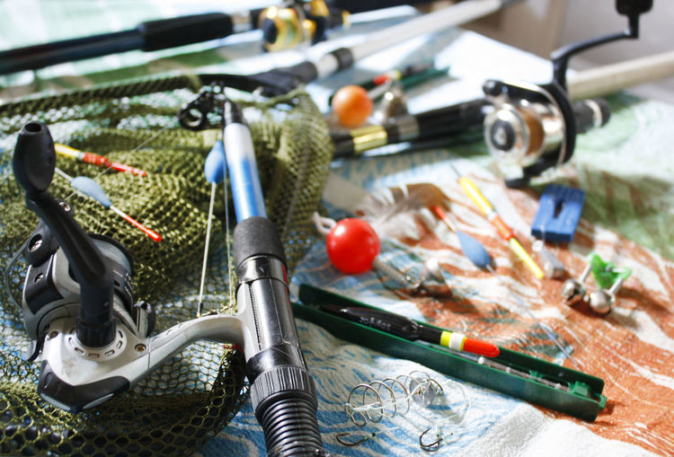 High angle view of fishing rods on table
