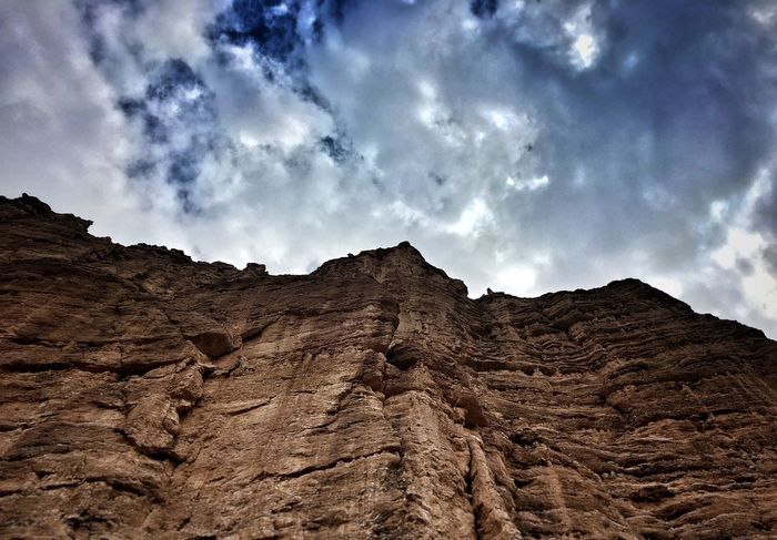 Low Angle View Tranquil Scene Sky Scenics Tranquility Mountain Cloud - Sky Physical Geography Tourism Beauty In Nature Travel Destinations Rock Formation Non-urban Scene Nature Majestic Brown Geology Vacations Remote Cloud