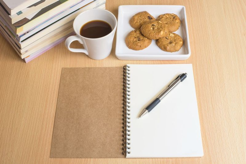 Book Close-up Coffee - Drink Coffee Cup Cookie Day Diary Drink Education Food Food And Drink Freshness Indoors  No People Paper Ready-to-eat Refreshment Spiral Notebook Table