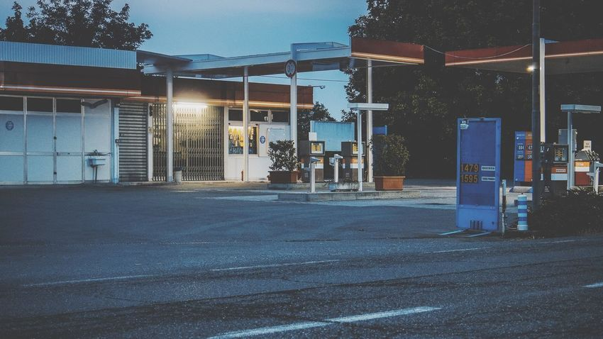 Gas station on the road Gas Station Fuel Pump Fuel And Power Generation Building Exterior Architecture Built Structure City Street Building Night Symbol Residential District No People Nature Street Light Road Transportation Direction Illuminated Outdoors Sign Communication City Life
