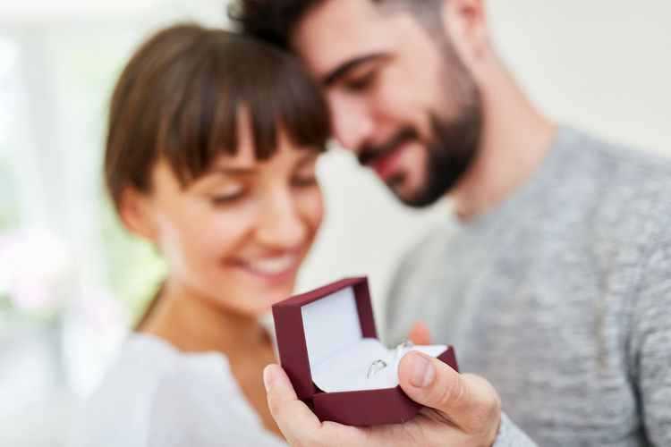 Proposal Wedding Rings Donate Love Man Woman Wedding Ring Buy Decision Marriage  Box Symbol Wedding Faithfulness  Rings Ring Engagement Partnership Engagement Ring Get Married Young Couple Relationship Female Male Joy People Lifestyle Together Partner Family Establish Affection Sign Purchase Jeweler Jewelry
