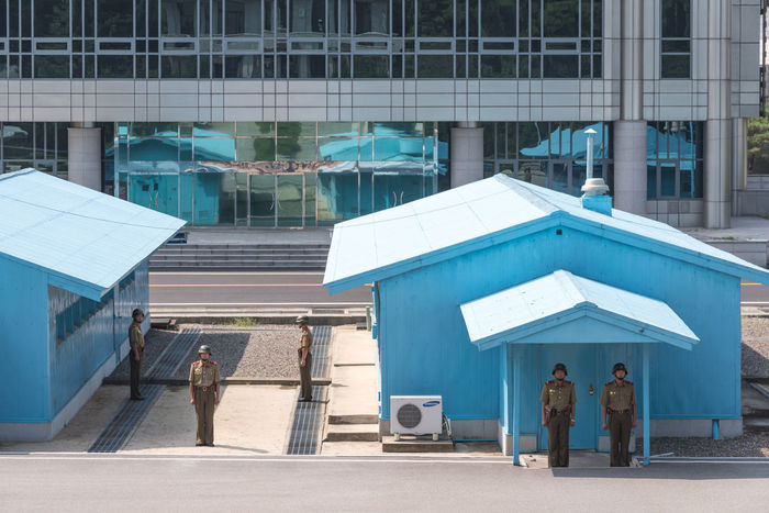 "The Joint Security Area (JSA) is the only portion of the Korean Demilitarized Zone (DMZ) where North and South Korean forces stand face-to-face. It is often called the ""Truce Village"" in both the media. This picture was taken from the North Korea side Communism DMZ, North Korea, South Korea DPRK DPRKorea JSA Korean Korean War North Korea Soldier Army Army Soldier Blue House Building Exterior Day Dmz Full Length Kaesong Separation Socialism Standing War"