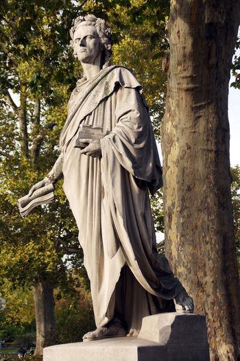 Friedrich Schiller statue at the opera in Stuttgart Famous Friedrich Schiller Poet Schiller Sculpture Statue Stuttgart Tourism Destination Writer