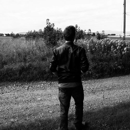 """adventures"" Rear View Adults Only Adult Only Men People Standing Nature Outdoors Sky Grass One Person Camera - Photographic Equipment Photography Themes Black & White Human Hand Looking At Camera Young Men Abstract Photography Film Industry Blackandwhiteworld White Background Chilling ✌ Photography"