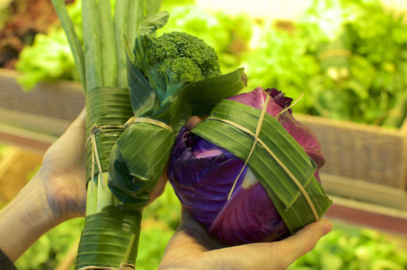 Vegetables wrapped in banana leaves. this is an excellent solution how replace plastic packaging