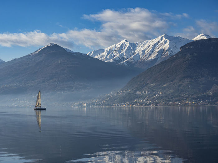 Single sail boat on lake como