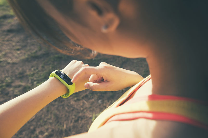Adult Close-up Day Fit Fitness Focus On Foreground Hand Holding Human Body Part Human Hand Leisure Activity Lifestyles Outdoors People Real People Selective Focus Smartwatch Sport Technology Time Two People Watch Women Wristwatch