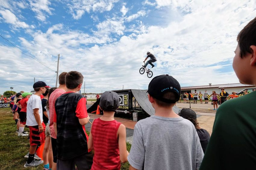 Nowear BMX Team Nebraska State Fair September 1, 2018 Grand Island, Nebraska Camera Work Check This Out Composition Event EyeEm Best Shots FUJIFILM X-T1 Fujinon 10-24mm F4 Getty Images Grand Island, Nebraska Nebraska State Fair NowearBMX Photojournalism Stunt Action Adult Bicycle Bmx  Cloud - Sky Crowd Day Extreme Sports Eye For Photography Eyeforphotography Freestyle Group Of People Leisure Activity Lifestyles Men Nature Outdoors People Real People Rear View S.ramos September 2018 Sky Spectator Sport Standing Togetherness Transportation Tricks Waist Up