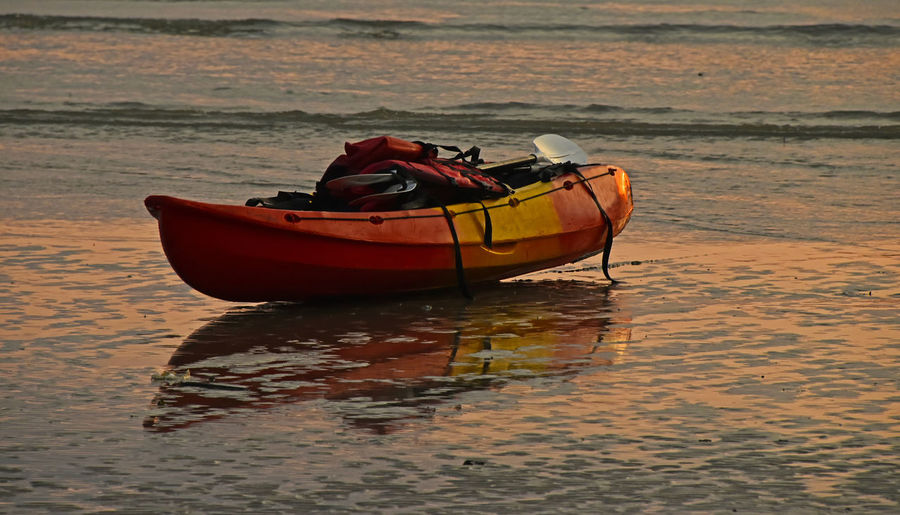 Kayak boat left on the beach during sunset Abandoned Adventure Beach Beach Photography Beachphotography Boat Hobbies Kajak Kayak Kayaking Left On The Beach Orange Red Sand Sea Seashore Seaside Sunset Sunset_collection Thailand Vacation Weekend Activities The Essence Of Summer Original Experiences Summer Exploratorium
