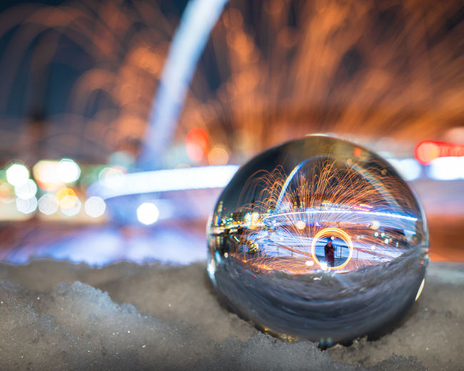 Mid adult man with wire wool reflecting on crystal ball