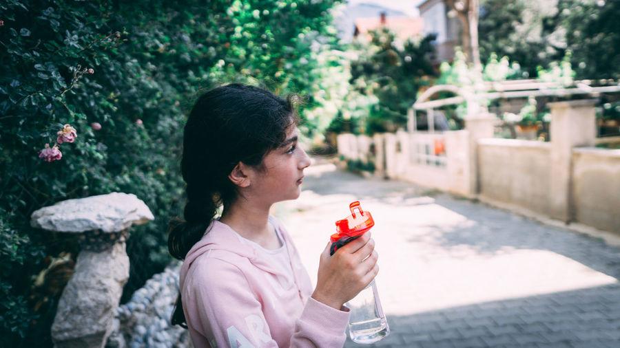 Full length of woman holding ice cream