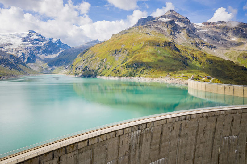 Aerial of dam and alpine water reservoirs, kaprun, austria