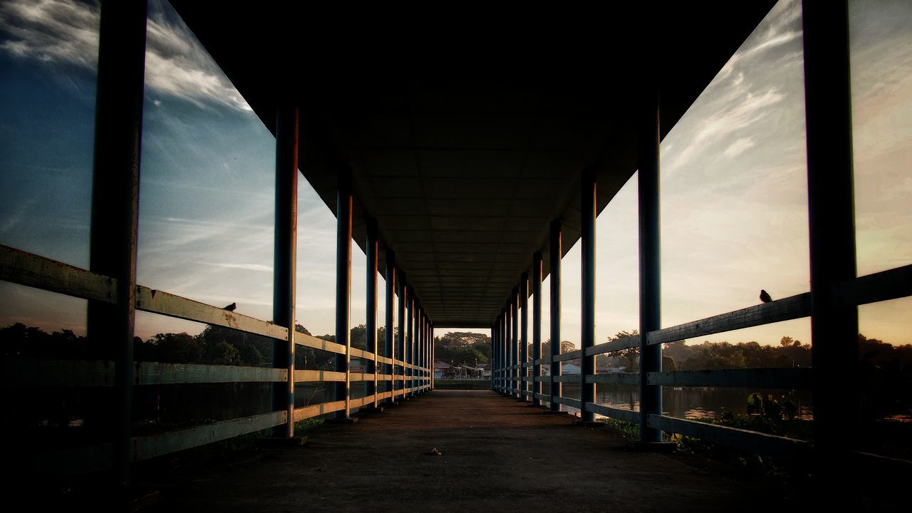 architecture, direction, the way forward, built structure, sky, bridge, diminishing perspective, no people, cloud - sky, nature, connection, transportation, railing, bridge - man made structure, indoors, day, empty, footpath, metal, ceiling, long