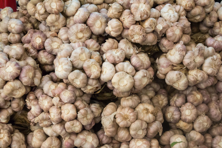 Full frame shot of garlic for sale at market stall
