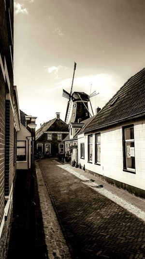 Typical Dutch Small Village Winsum. Windmill 'The Star' build in 1851 in Sepia Tone Loving Vintage Monochrome