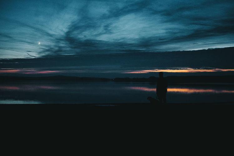 Sky Cloud - Sky Beauty In Nature Scenics - Nature Water Tranquility Tranquil Scene Sunset Silhouette Nature Sea Idyllic Dramatic Sky Dark Outdoors Non-urban Scene No Recognizable People Lake Dog EyeEmNewHere EyeEm Best Shots EyeEm Nature Lover EyeEm Best Edits Brandenburg Moon Autumn Mood