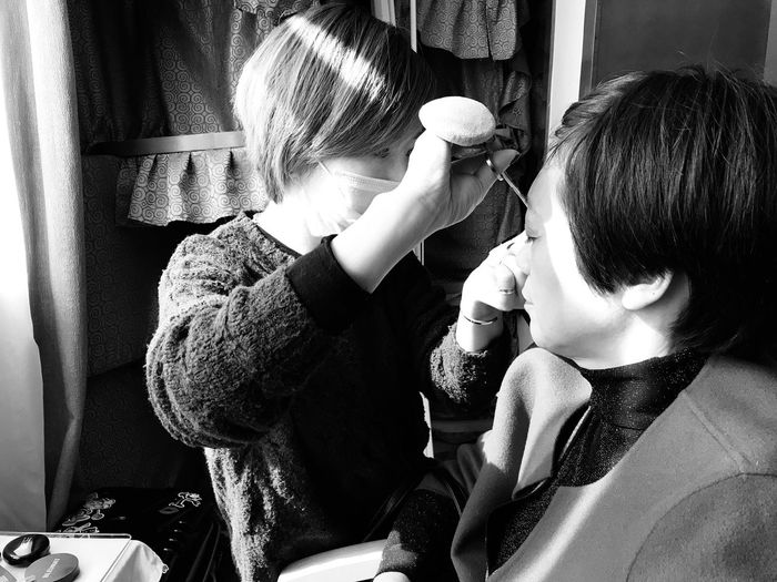 Beautician Doing Make-Up Of Woman