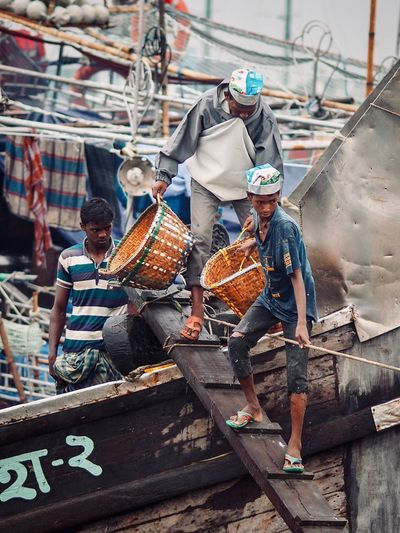 Bangladeshi Bangladesh 🇧🇩 Bangladesh Port Chittagong Occupation Men Nautical Vessel Day Real People Architecture Group Of People Working Transportation People Food And Drink Fishing Industry Outdoors Food Built Structure Business Finance And Industry Business Mode Of Transportation Adult
