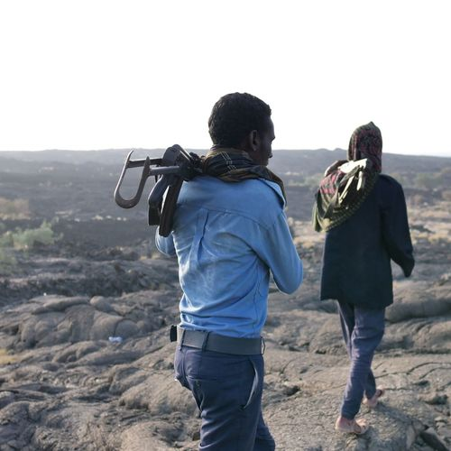 Afar Ethiopia Africa Erta Ale Vulcano Guard AK47 Armed Men Togetherness Mountain Women Rear View The Photojournalist - 2019 EyeEm Awards The Traveler - 2019 EyeEm Awards