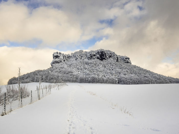 Lilienstein Saxon Switzerland Sächsische Schweiz Cloud - Sky Winter Mountain Rock Formation Sky Snow Landscape Nature Beauty In Nature Snowcapped Mountain Non-urban Scene Mountain Peak National Park Winter Season  White Color Cold Temperature Scenics - Nature No People Tree Tranquil Scene