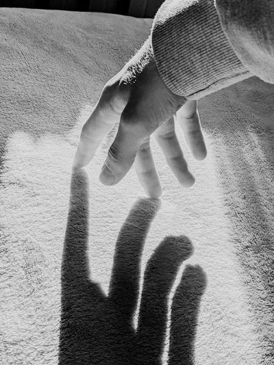 Shadow of couple on hands