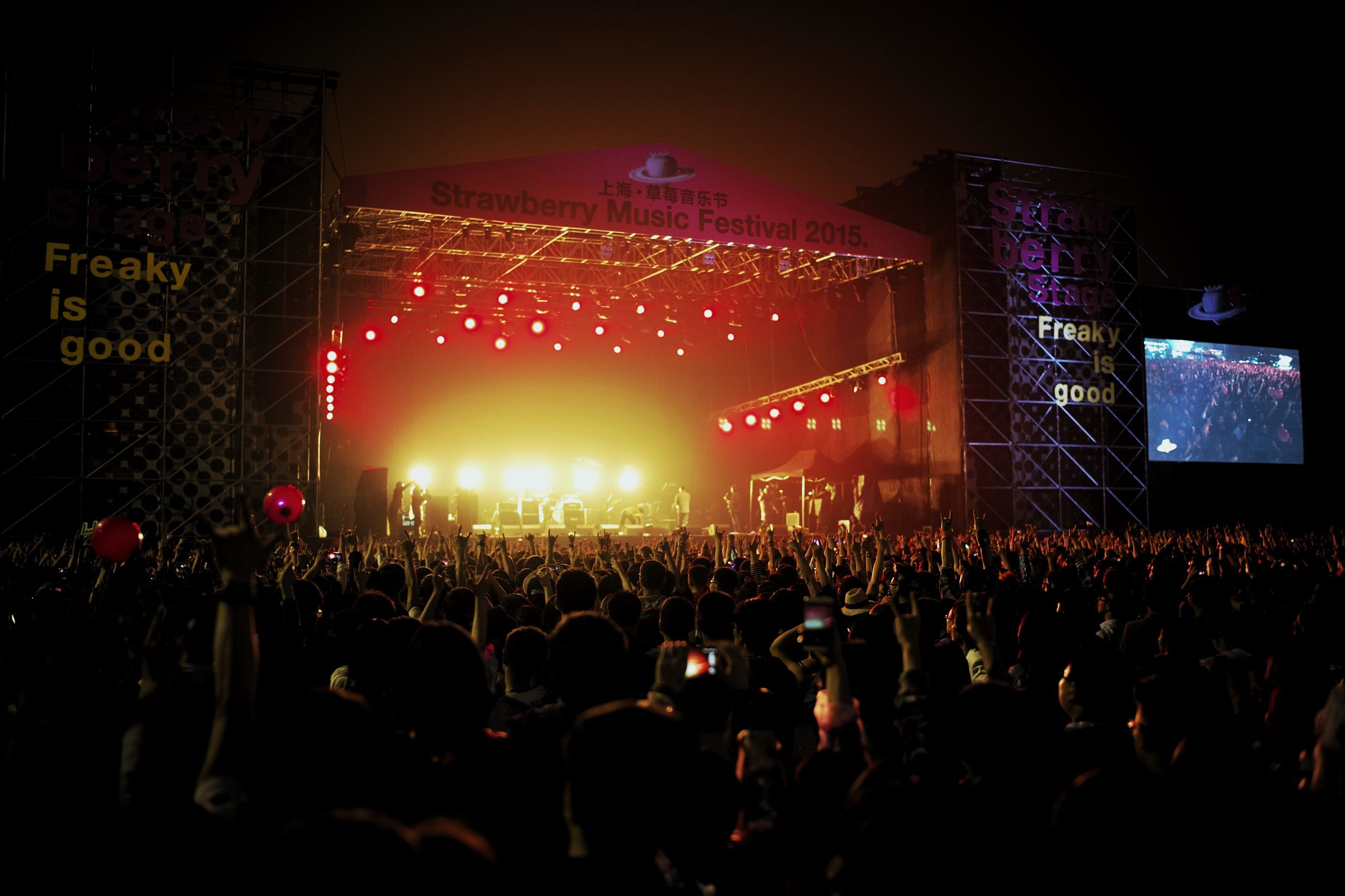large group of people, illuminated, crowd, night, music, arts culture and entertainment, event, person, performance, lifestyles, celebration, enjoyment, nightlife, men, stage - performance space, music festival, leisure activity, concert
